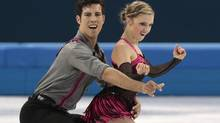 Paige Lawrence and Rudi Swiegers of Canada compete in the pairs short program figure skating competition at the Iceberg Skating Palace during the 2014 Winter Olympics, Tuesday, Feb. 11, 2014, in Sochi, Russia. (Ivan Sekretarev/AP)
