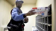 George Graves-Sampson delivers mail in Toronto the old-fashioned way, but with the revamped ePost service, Canada Post is now chasing digital business. (Matthew Sherwood for The Globe and Mail/Matthew Sherwood for The Globe and Mail)