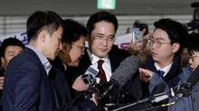Jay Y. Lee, centre, vice-chairman of Samsung Electronics, arrives to be questioned as a suspect in bribery case in the influence-peddling scandal that led to the president's impeachment at the office of the independent counsel in Seoul, South Korea, Thursday, Jan. 12, 2017. (REUTERS)