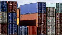Containers wait in the harbour of Hamburg, Germany. (Philipp Guelland/Philipp Guelland/AP)