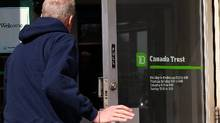File photo of a customer entering a TD branch in Toronto. (Deborah Baic/The Globe and Mail)