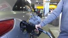 A customer fills up at a gas station in downtown Toronto. (Fred Lum/Fred Lum/The Globe and Mail)