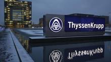 The Essen headquarters of Germany's industrial conglomerate ThyssenKrupp AG is pictured in a file photo. Germany's biggest steel maker warned Feb. 12 that it sees no global economic recovery in 2013 after a slump in steel prices and weak car markets caused a 38-per-cent drop in its quarterly core profit. (INA FASSBENDER/REUTERS)