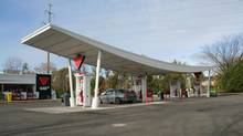 The Canadian Tire gas bar at Southdown Road, Mississauga, Ont. features a restored swooping, retro-futuristic, concrete canopy over the gas pumps. (Dave LeBlanc For The Globe and Mail)