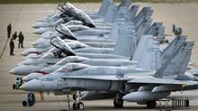 CF-18's in CFB Cold Lake, AB September 28, 2010 are line up on the tarmac before take off. (JOHN LEHMANN/The Globe and Mail/JOHN LEHMANN/The Globe and Mail)