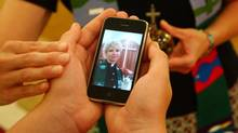 An iPod is blessed at Saint Timothy's church in Hatchet Lake, Nova Scotia on Sept. 1, 2010. (PAUL DARROW For The Globe and Mail)