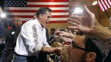 U.S. Republican presidential candidate and former Massachusetts Governor Mitt Romney greets supporters during a campaign rally in North Charleston, South Carolina, January 20, 2012. (JIM YOUNG/REUTERS)