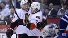 Ottawa Senators' Kyle Turris, centre, celebrates his goal against the Toronto Maple Leafs with teammate Jared Cowen, 2, during first period NHL action in Toronto on Saturday October 5, 2013. (Frank Gunn/THE CANADIAN PRESS)