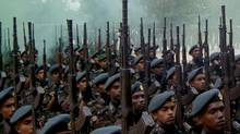 Sri Lankan air force soldiers march during a passing out parade at an air base in Ampara, January 9, 2009. (STR/SRI LANKA/REUTERS)