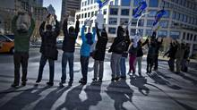 British Columbia teachers protest for better student learning conditions outside the cabinet offices in Vancouver, March 18, 2013. The opposition New Democrats said Feb. 12, 2014 that court documents show the Liberal government was intent on provoking teachers into job action, rather than bargaining in good faith. (ANDY CLARK/REUTERS)