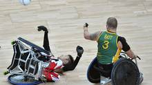 Trevor Hirschfield of Canada (L) collides with Ryley Batt of Australia during the Wheelchair Rugby final at the London 2012 Paralympic Games September 9, 2012. (TOBY MELVILLE/REUTERS)