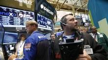 Traders work on the floor of the New York Stock Exchange, June 29, 2012. (Brendan McDermid/Reuters)