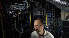 Neuroscientist Randy McIntosh with his virtual brain, composed of powerful computers and racks of servers. (Fred Lum)