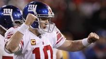 New York Giants quarterback Eli Manning celebrates after throwing a touchdown pass against the San Francisco 49ers in the fourth quarter during the NFL NFC Championship game in San Francisco, California, January 22, 2012. (JEFF HAYNES/REUTERS)