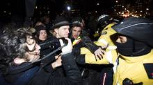 Occupy Toronto protesters clash with police while they march north on University Ave. in Toronto on Friday March 30, 2012. Toronto police say four Occupy Toronto protesters are under arrest following their eviction from a camp near city hall on Friday afternoon. (Aaron Vincent Elkaim/THE CANADIAN PRESS)