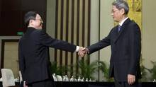 Wang Yu-chi, left, head of Taiwan's Mainland Affairs Council, shakes hands with Zhang Zhijun, director of China's Taiwan Affairs Office, before their meeting in Nanjing, in eastern China's Jiangsu Province, Tuesday, Feb. 11, 2014. Taiwan and China are holding their highest-level talks since splitting amid a civil war 65 years ago. (Alexander F. Yuan/AP)