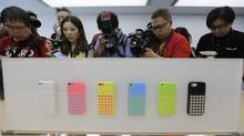 Apple's latest offering to the technology revolution? Coloured phones. (JASON LEE/REUTERS)
