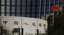 China's national flag flies in front of the headquarters of the People's Bank of China, the central bank, in Beijing in this November 30, 2011 file photo. (Reuters)