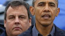 U.S. President Barack Obama speaks after a tour around the damage done by Hurricane Sandy in Brigantine, New Jersey, October 31, 2012. New Jersey Governor Chris Christie stands behind Obama. (LARRY DOWNING/REUTERS)