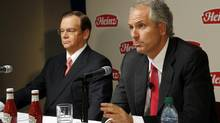 3G Capital managing partner Alex Behring, right, speaks as Heinz CEO William R. Johnson listens at a news conference to announce that Heinz has agreed to be bought by Berkshire Hathaway and 3G Capital. (JASON COHN/REUTERS)