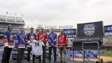 NHL hockey players, from left, Matt Moulson, Ryan Callahan, John Tavares, Bryce Salvador, Dan Girardi, and Andy Greene pose for photographers during a news conference, Thursday, Aug. 8, 2013 at Yankee Stadium in New York. (Mary Altaffer/AP)