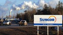File photo of workers leaving the Suncor oil sands extraction facility near the town of Fort McMurray, Alta. (MARK RALSTON/AFP/Getty Images)