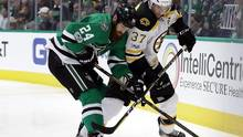 Jordie Benn defends against Patrice Bergeron in the second period at American Airlines Center on February 26, 2017 in Dallas, Texas. (Ronald Martinez/Getty Images)