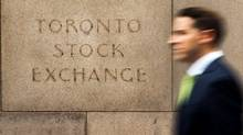A man walks past an old Toronto Stock Exchange (TSX) sign in Toronto, June 23, 2014. (Mark Blin/Reute)