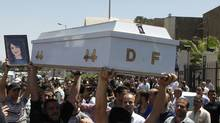 Mourners carry the coffin of Dima Farah, who was killed in Thursday's suicide bomb attack, during her funeral at the Mar Elias monastery in Damascus May 12, 2012. A video posted online in the name of a shadowy militant group is claiming responsibility for the twin suicide bombings in the Syrian capital this week that killed 55 people. (KHALED AL-HARIRI/Reuters/KHALED AL-HARIRI/Reuters)