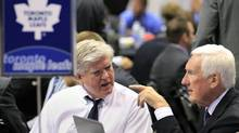 Toronto Maple Leaf's General Manager Brian Burke (L) and team advisor Cliff Fletcher chat before the first round of the 2010 NHL hockey entry draft in Los Angeles, California June 25, 2010. REUTERS/Mike Blake (MIKE BLAKE)