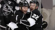 Los Angeles Kings left wing Dustin Penner, left, and teammate Trevor Lewis celebrate a goal by Penner during the third period of an NHL hockey game against the San Jose Sharks in Los Angeles, Tuesday. (Jae C. Hong/Associated Press)