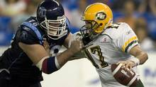 Toronto Argonauts' Adriano Belli sacks Edmonton Eskimos' quarterback Stefan LeFors in the second half of their CFL game in Toronto, Oct. 6, 2007. (Fred Thornhill/Reuters/Fred Thornhill/Reuters)