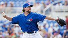 Toronto Blue Jays starting pitcher R.A. Dickey throws against the Boston Red Sox during first inning MLB Grapefruit League baseball action Dunedin, Fla., on Monday. (Nathan Denette/THE CANADIAN PRESS)