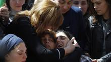 The mother of seven-year-old Miriam Monsonego (bottom R) mourns during the joint funeral service in Jerusalem for her daughter and the other three victims of Monday's shooting in Toulouse March 21, 2012. (BAZ RATNER/REUTERS/BAZ RATNER/REUTERS)