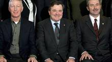 Federal Finance Minister Jim Flaherty, centre, is shown with his provincial counterpart, PEI's Wes Sheridan, in 2010. (Jeff McIntosh/The Canadian Press)