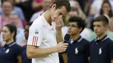 Andy Murray of Britain reacts during a television interview with Sue Barker after being defeated by Roger Federer of Switzerland in their men's singles final tennis match at the Wimbledon Tennis Championships in London July 8, 2012. (STEFAN WERMUTH/REUTERS)