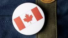 canadian flat button on a bag (Photos.com)
