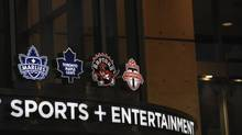 Photos of team logos above the entrance to Maple Leaf Sports and Entertainment located at the Air Canada Centre (Fred Lum/Fred Lum/The Globe and Mail)