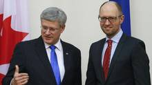 Ukrainian Prime Minister Arseny Yatseniuk, right, meets with Canadian Prime Minister Stephen Harper in Kiev, March 22. (Gleb Garanich/Reuters)