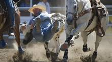 Wade Sumpter of Fowler, Colo., competes in the steer wrestling-event during the 101st Calgary Stampede on July 14, 2013. (KEVIN VAN PAASSEN/THE GLOBE AND MAIL)