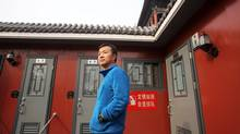 Henry Wu, inventor of the Landwasher toilet, stands in front of his invention in the Forbidden City in central Beijing. (Sean Gallagher For The Globe and Mail)