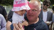 Toronto Mayor Rob Ford holds a baby as he attends the CHIN International Picnic, on his first day back in public since returning from a rehabilitation clinic for substance abuse problems in Toronto, July 1, 2014. Toronto Mayor Rob Ford, who shot to prominence last year after admitting to smoking crack, buying illegal drugs and driving after drinking, insisted for months he did not have a problem. But last month he said he would take time off to deal with his drinking issues in rehabilitation and has now returned to office. REUTERS/Mark Blinch (CANADA - Tags: POLITICS SOCIETY) (MARK BLINCH/REUTERS)