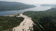 Debris from a tailings pond flows down Hazeltine Creek into Quesnel Lake near the town of Likely, B.C., on Aug. 5, 2014. (Jonathan Hayward/The Canadian Press)