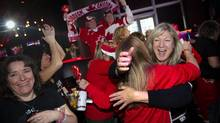 Fans celebrate a gold medal win as Canada defeats the United States in women's Olympic ice hockey at the Real Sports Bar in Toronto on Feb. 20, 2014. (KEVIN VAN PAASSEN/THE GLOBE AND MAIL)
