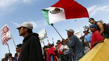 Farmworkers march during a demonstration in San Isidro on the border between the U.S. and Mexico, in Tijuana in Baja California state, March 29, 2015. (EDGARD GARRIDO/REUTERS)