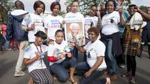 A group of coworkers show off their specially-made t-shirts celebrating Nelson Mandela (Michael Rajzman)