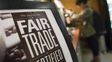 A British study found that workers who produce Fairtrade-certified coffee, tea and flowers are often underpaid. (Ben Nelms For The Globe and Mail)