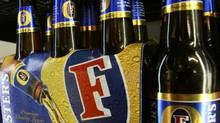 A six-pack of Foster's beer, the flagship product of Foster's Group. (MICK TSIKAS/REUTERS)