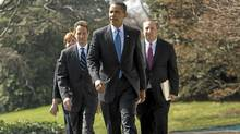 President Obama leads his economic team to the South Lawn of the White House in Washington, Wednesday, March 18, 2009, to make a statement on AIG. From left are, Council of Economic Advisers Director Christina Romer, Treasury Secretary Timothy Geithner, the president, and Director of the National Economic Council Lawrence Summers. (Evan Vucci/AP)