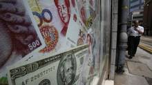 China's central bank issued a statement confirming it has intervened to alleviate the cash crunch and stabilize money-market rates. (BOBBY YIP/REUTERS)